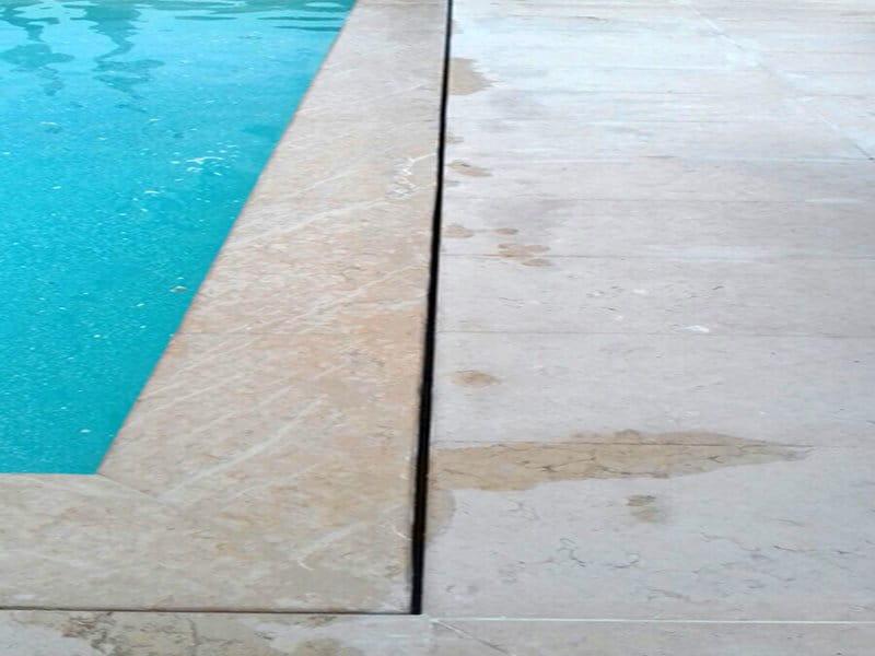 Bordo piscina in pietra riparato dopo intervento di esperto